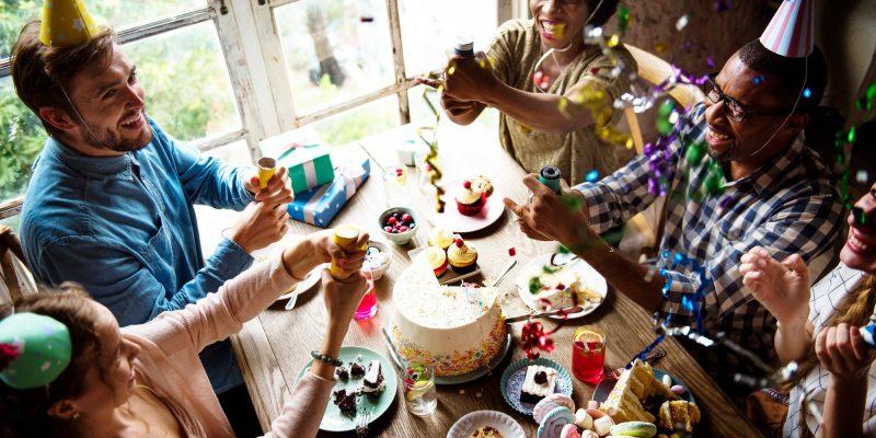 people-using-party-popping-on-friend-birthday-celebration.jpg